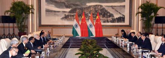 prime_minister_narendra_modi_discussing_india-china_ties_with_chinese_president_xi_jinping.jpg